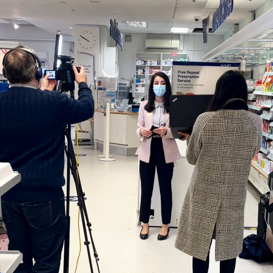 Behind the scenes shot of Pharmacist Melissa filming a video about Maskne with the Boots PR team